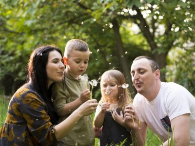 happy-parents-with-kids-nature_23-2148201500